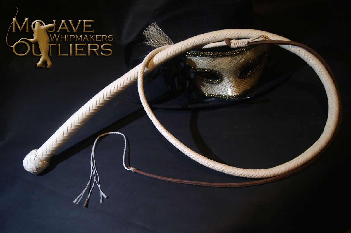 "This is an example of a snake whip (built 3-14-2018) with an all white Falconry Grade overlay, at 16 plait (4ft long).  I used kinda ""dramatic"" lighting with only a key light, because the white tends to reflect light a lot more.  Even so, as you can see the heavier leather (in this case, the hide measured 1.43 mm at the tail) creates more of a profile compared to regular thicknesses of kangaroo lace.  She is nonetheless quite smooth, because I beveled both sides of the lace on the underside."