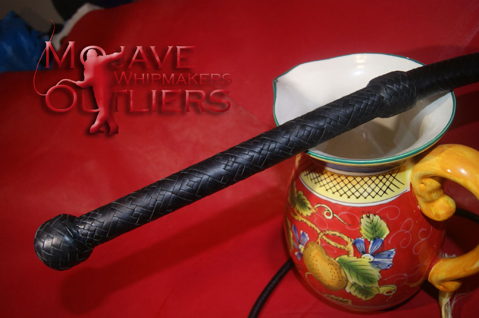 Detail of the handle of the 8ft bullwhip above.  This is 24 plait in black and forest green.