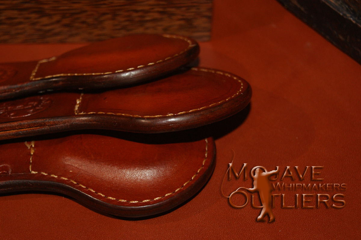 Detail showing the finished edges of the saddle tan Pocket Paddles.