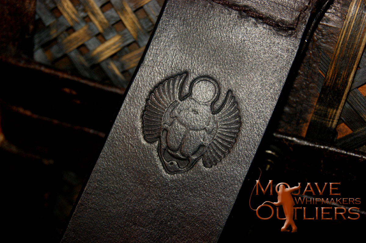 Detail of the Scarab Beetle stamp in the show brown Pocket Paddle.